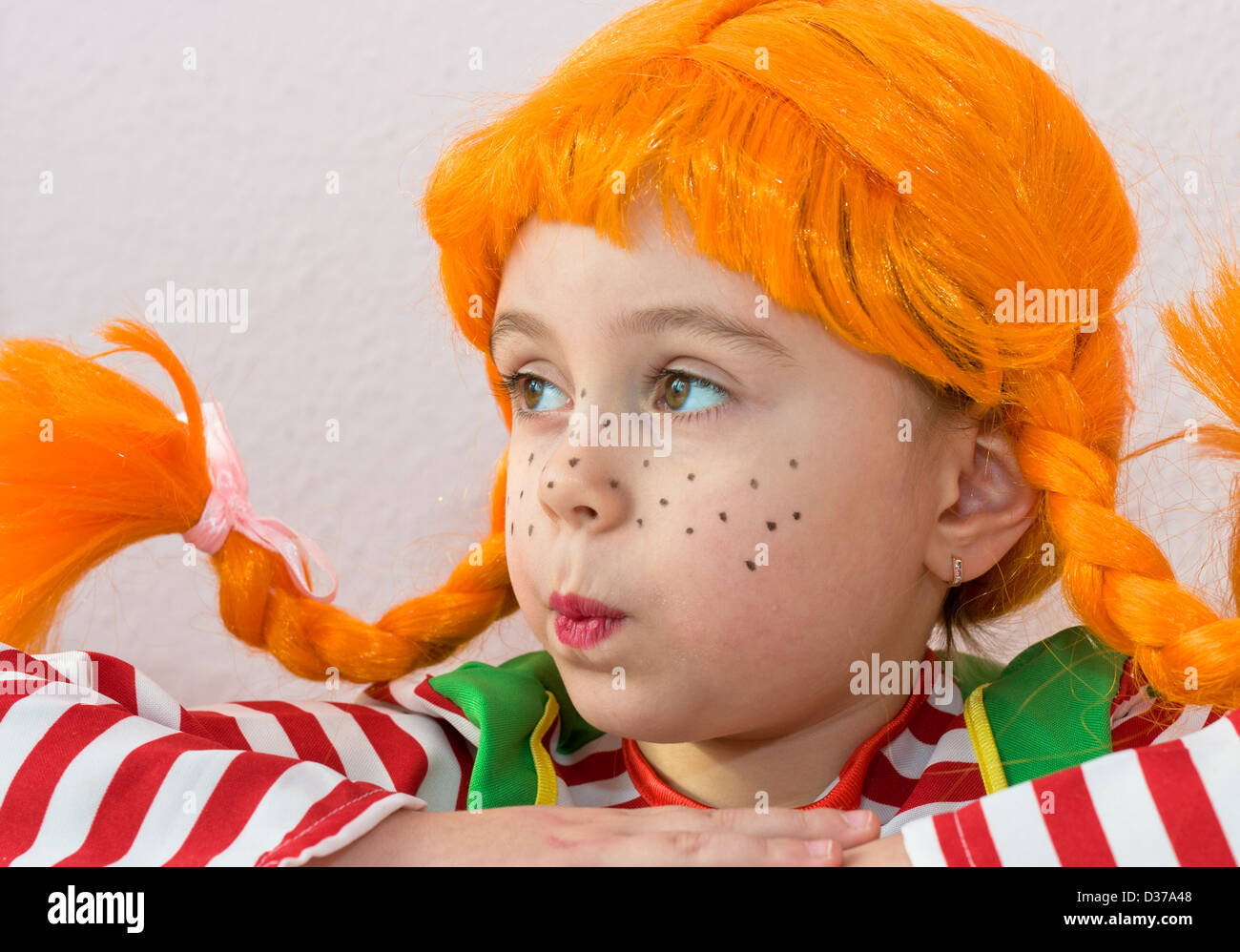 plaits, hair, pippi, child, bizarre, humor, displeased, fun, childhood, people, yellow, red - Stock Image