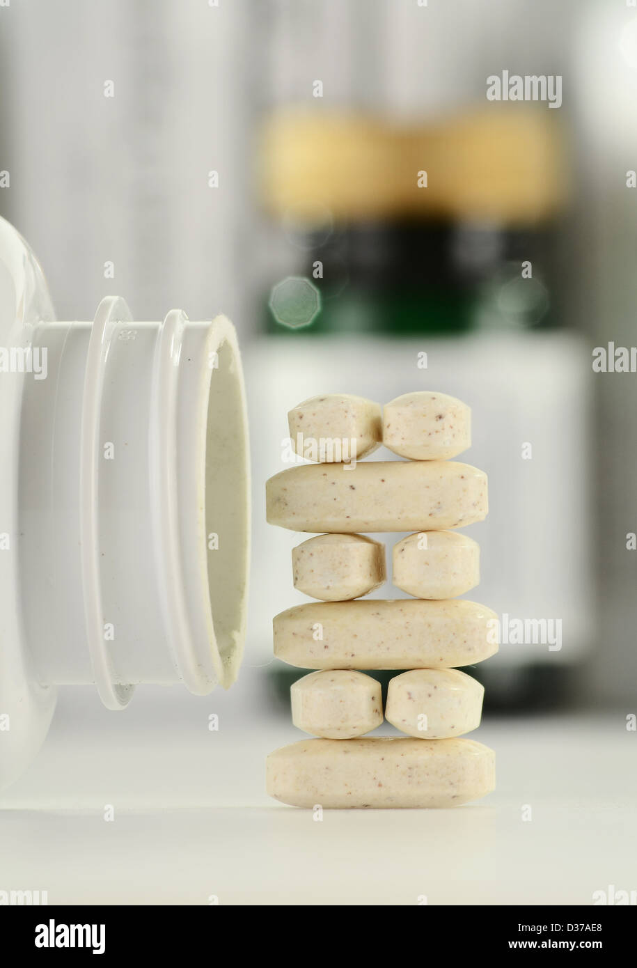 Composition with dietary supplement pills and containers - Stock Image