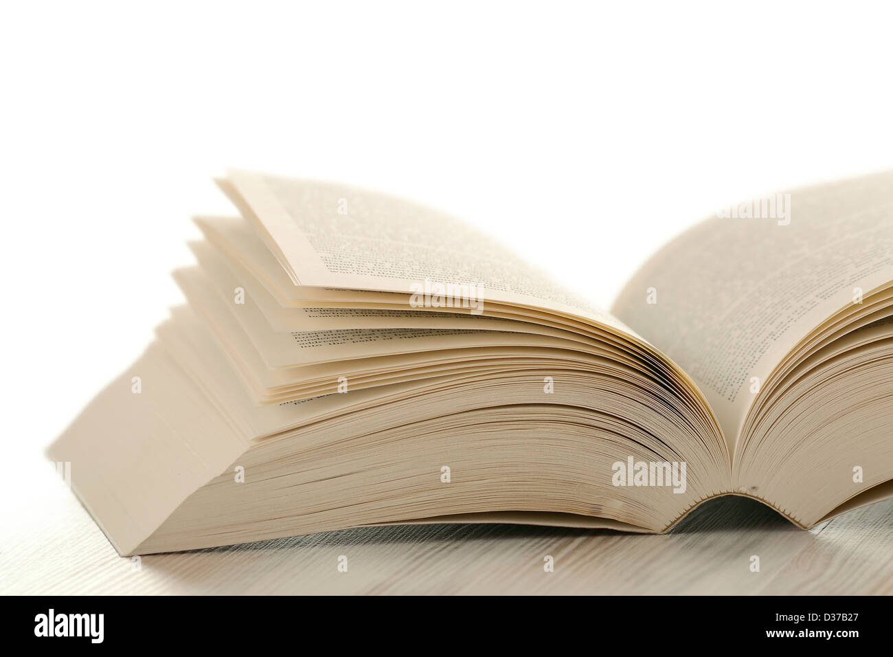 Book on the table over white background - Stock Image
