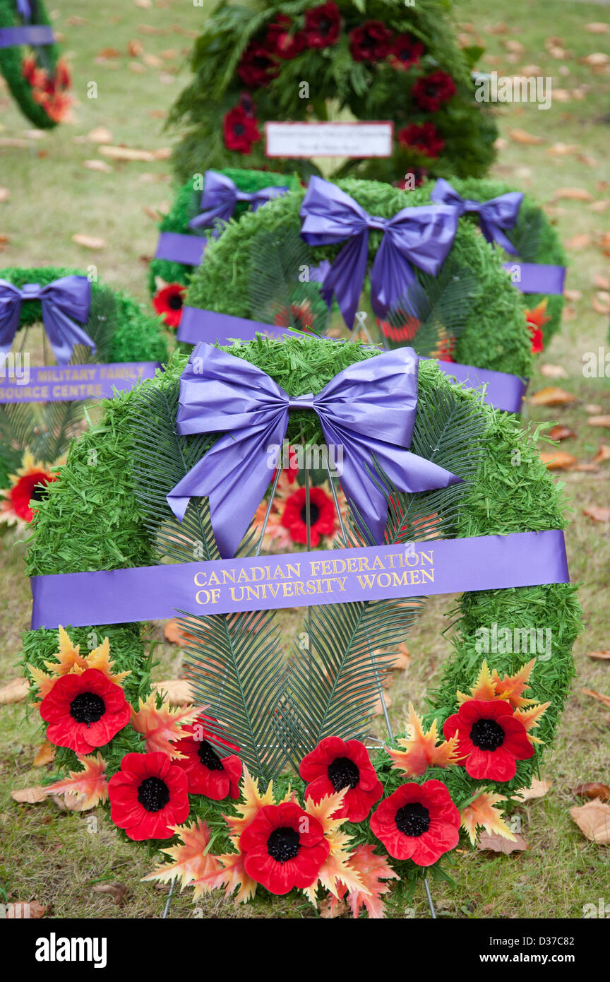 Remembrance Day wreaths covered in poppies - Stock Image