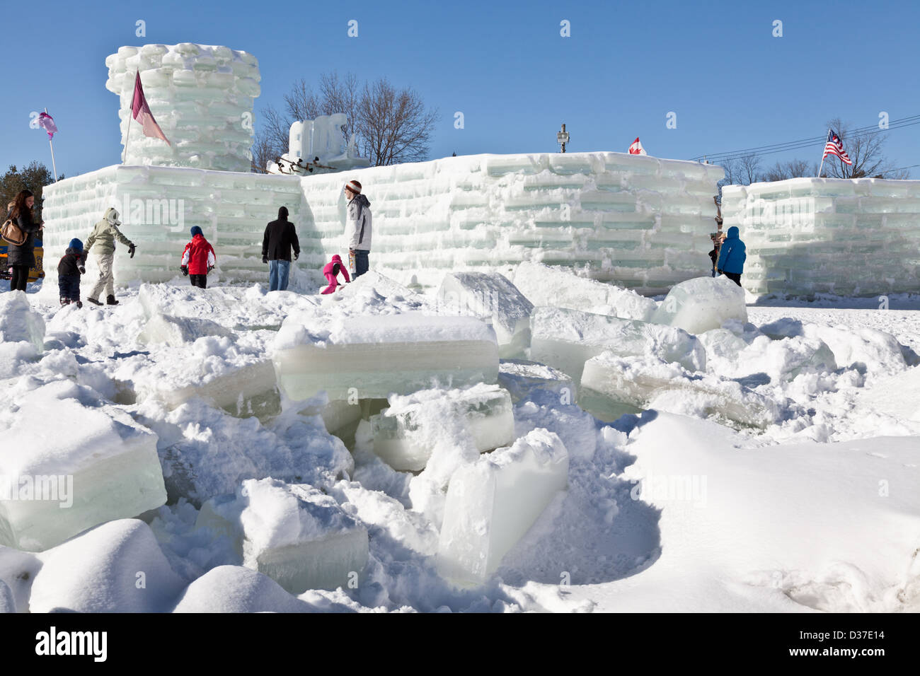 Children and families explore the ice palace at Saranac Lake Winter Carnival, Adirondacks, New York State - Stock Image