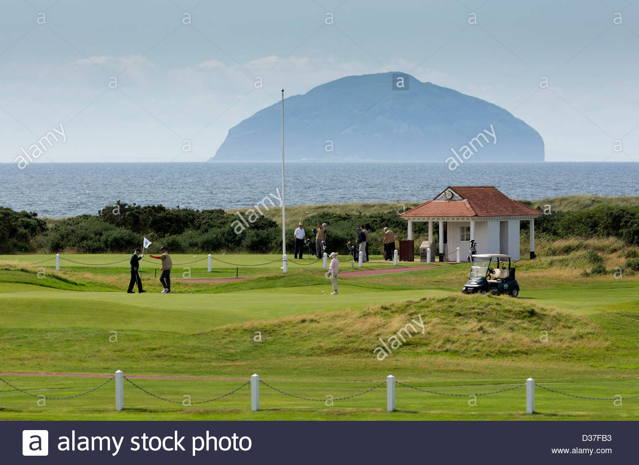 Golfers on one of the courses at Turnberry, with the Ailsa Craig in the distance. Turnberry Hotel and Golf Resort, - Stock Image