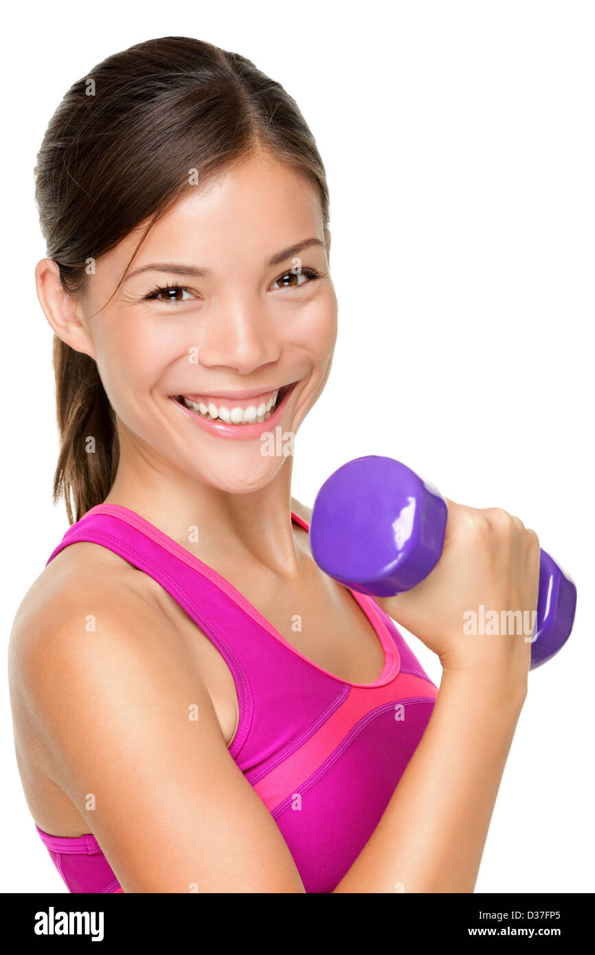 Portrait of happy mixed Caucasian  Asian fit woman lifting dumbbells isolated on white background - Stock Image