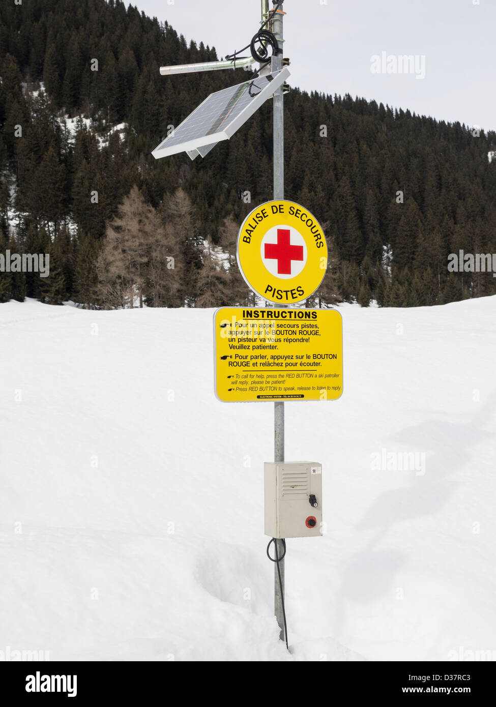 Solar powered emergency telephone to ski patrol on les Cascades snow slope in Le Grand Massif skiing area in French - Stock Image