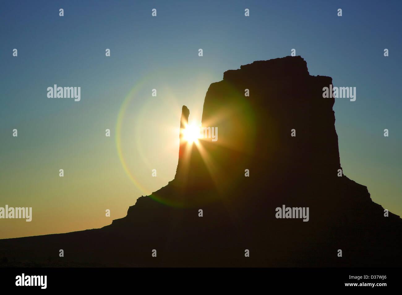 East Mitten and sunburst, Monument Valley, Arizona Utah border USA - Stock Image