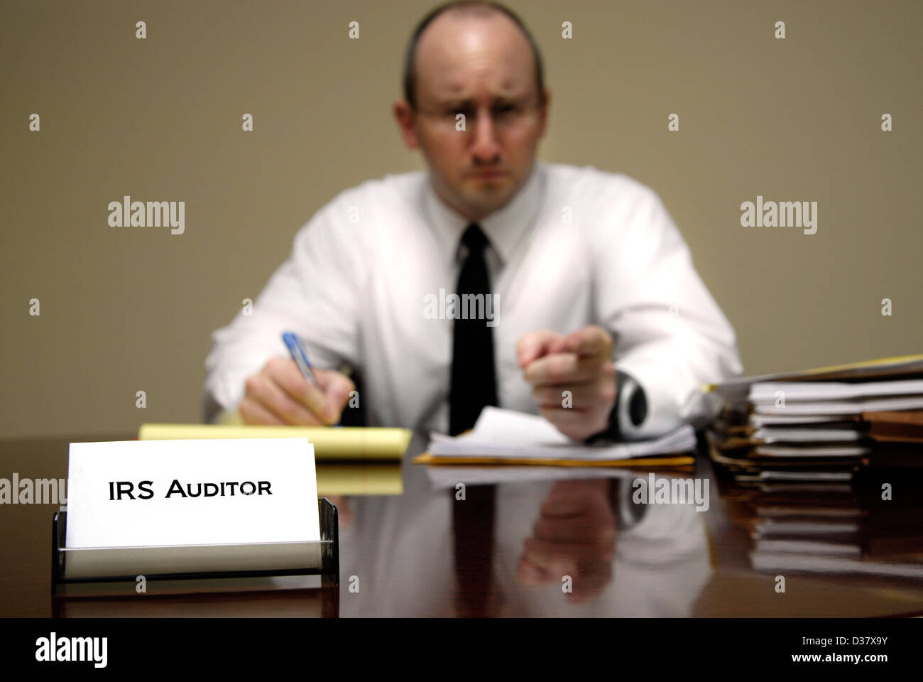 IRS tax auditor man with a stern or mean expression - Stock Image