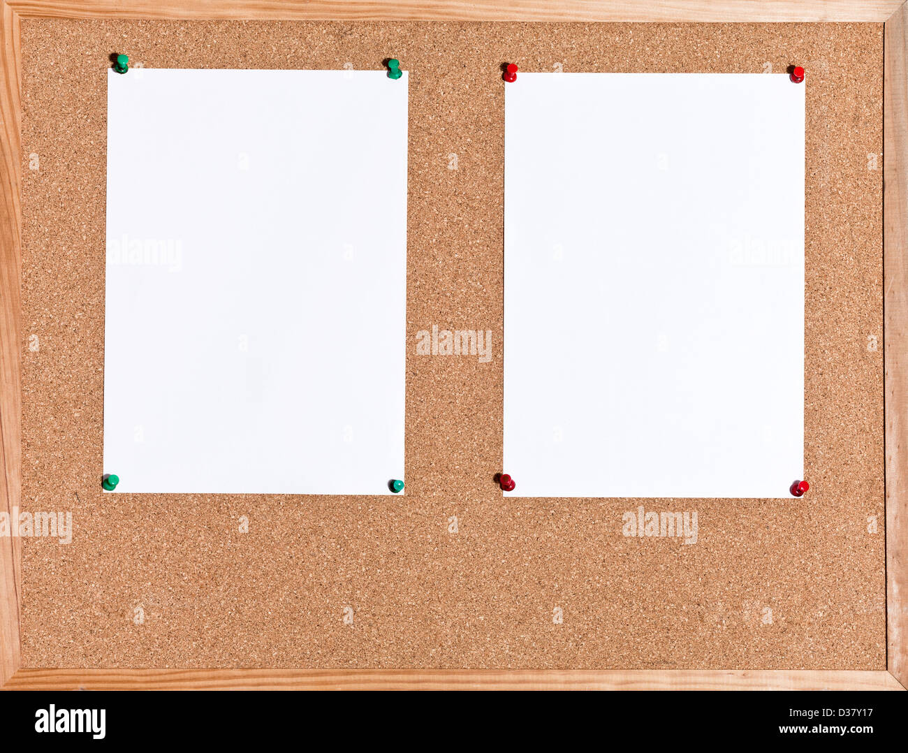 two white sheets of paper on cork board in wooden frame Stock Photo ...