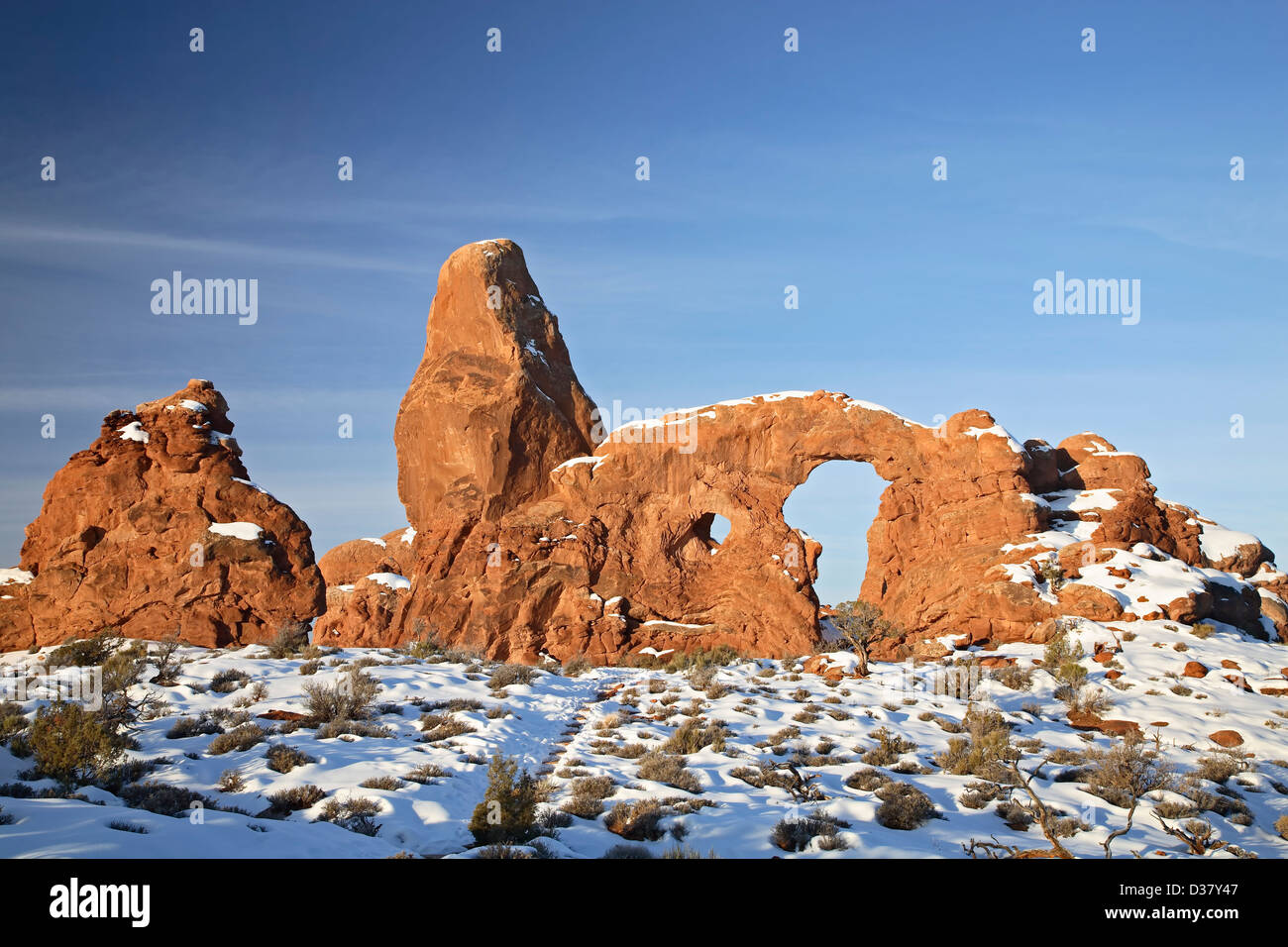Turret Arch under snow, The Windows, Arches National Park, Moab, Utah USA - Stock Image