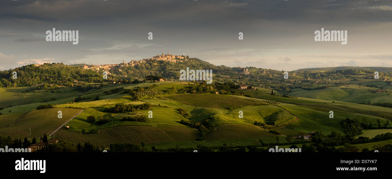 a panoramic view of a town of tuscany in the light of a sunset - Stock Image