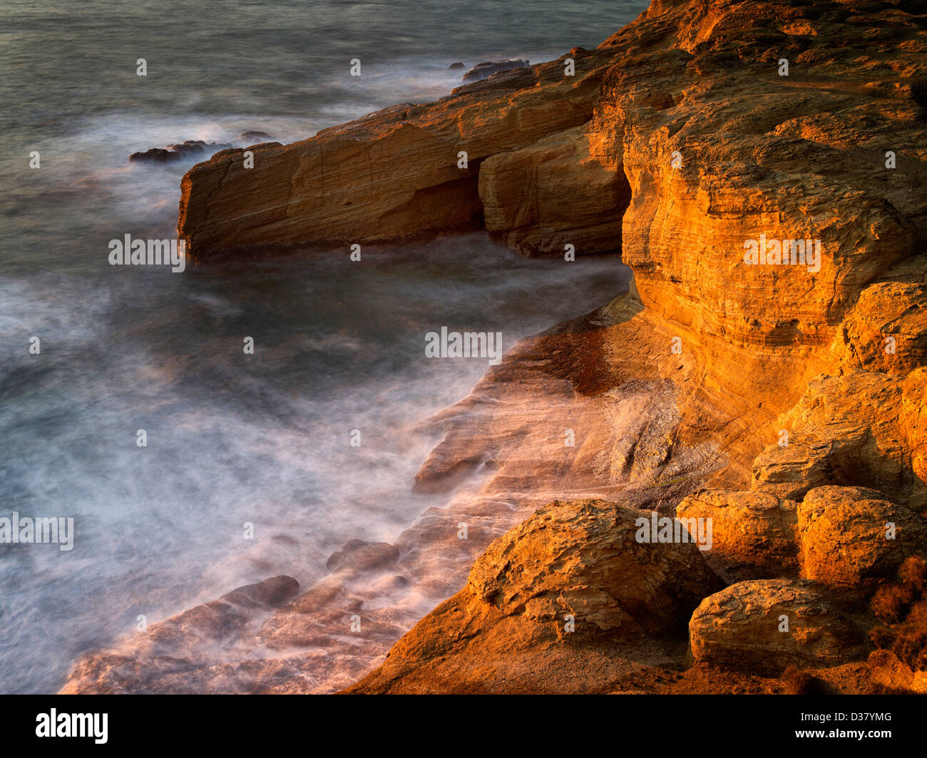 Rock formation and waves at Devil's Punchbowl, Oregon - Stock Image