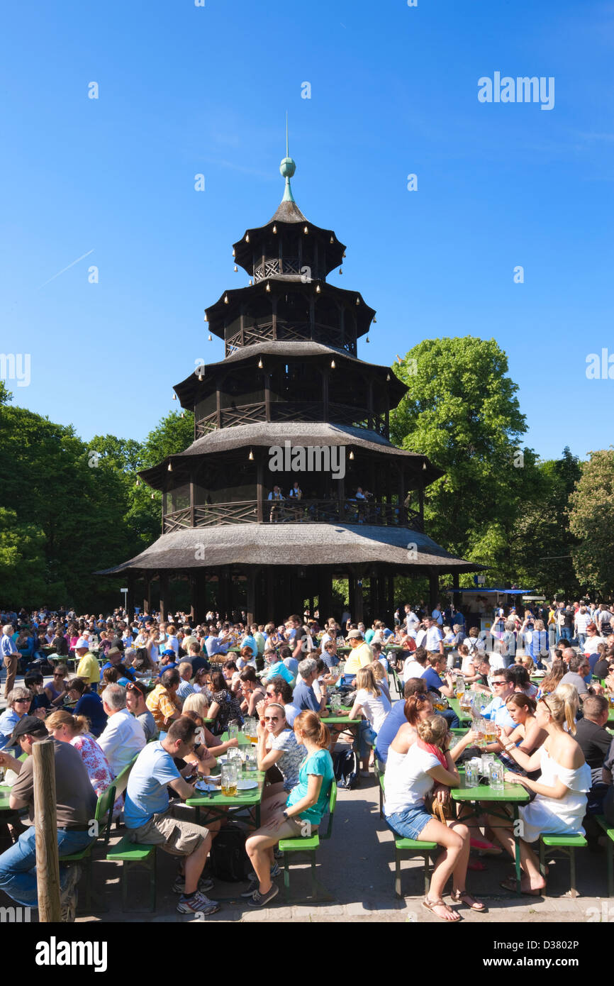 People drinking in The Chinese Tower beer garden, Englischer Garten, Munich, Bavaria, Germany - Stock Image