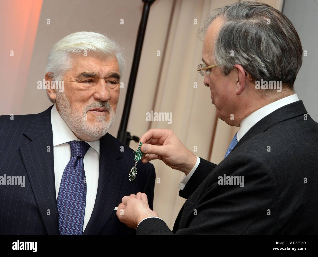French ambassador Maurice Gourdault-Montagne (R) awards German actor Mario Adorf as 'Chevalier des arts et des - Stock Image