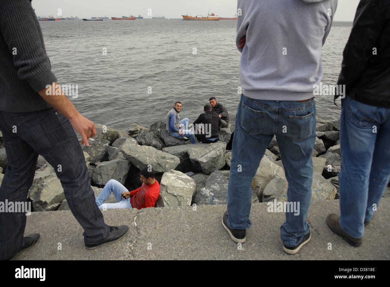 Istanbul, Turkey, young men on the coast of the Marmara Sea Sundays - Stock Image