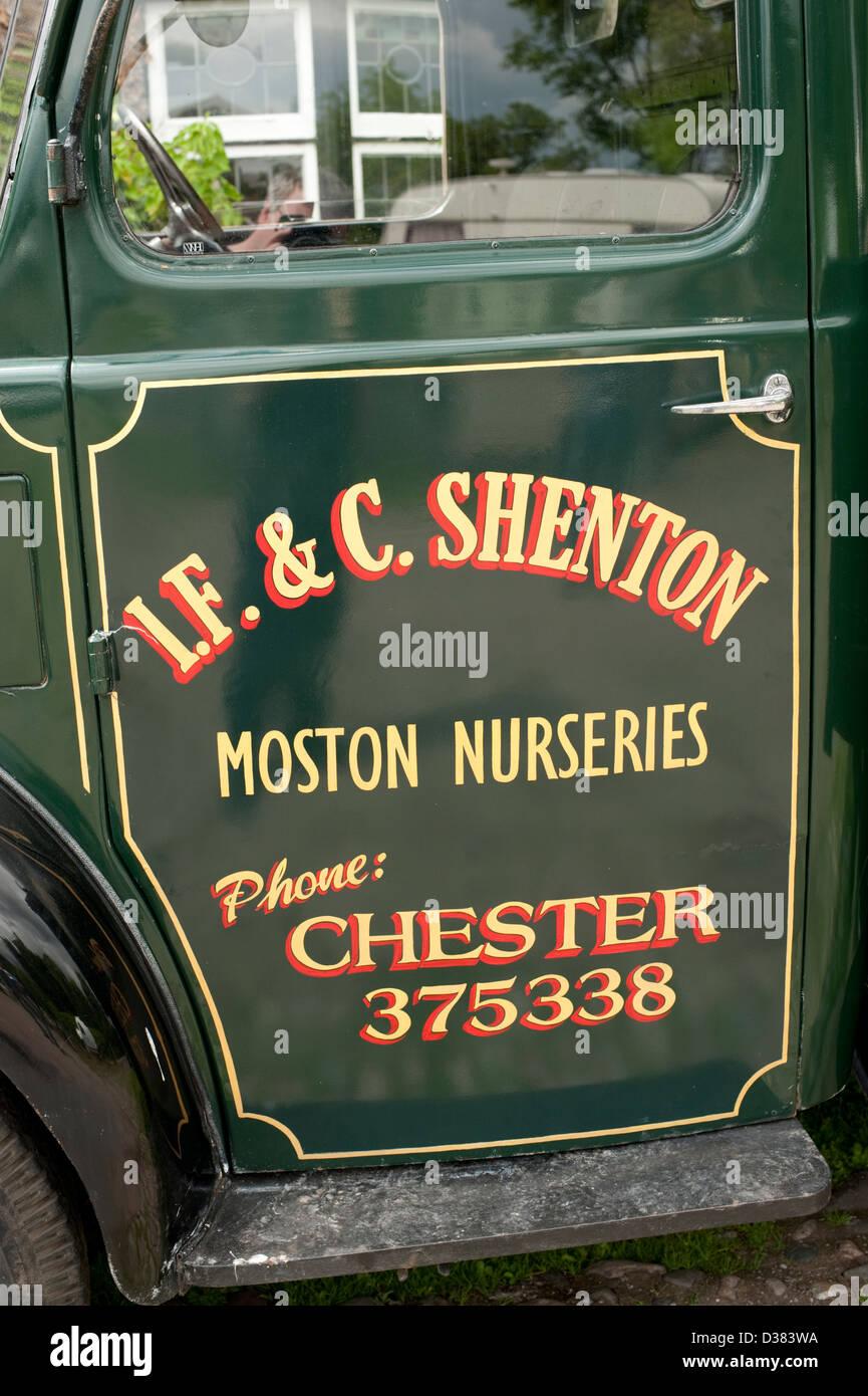 adbfa84a300d93 Old farm delivery van livery painting moston nurseries - Stock Image