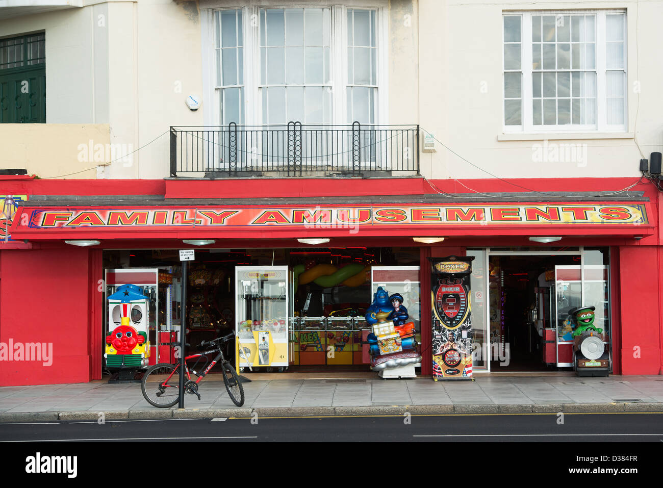 The red exterior of a Family Amusement arcade in Hastings near the promenade. - Stock Image