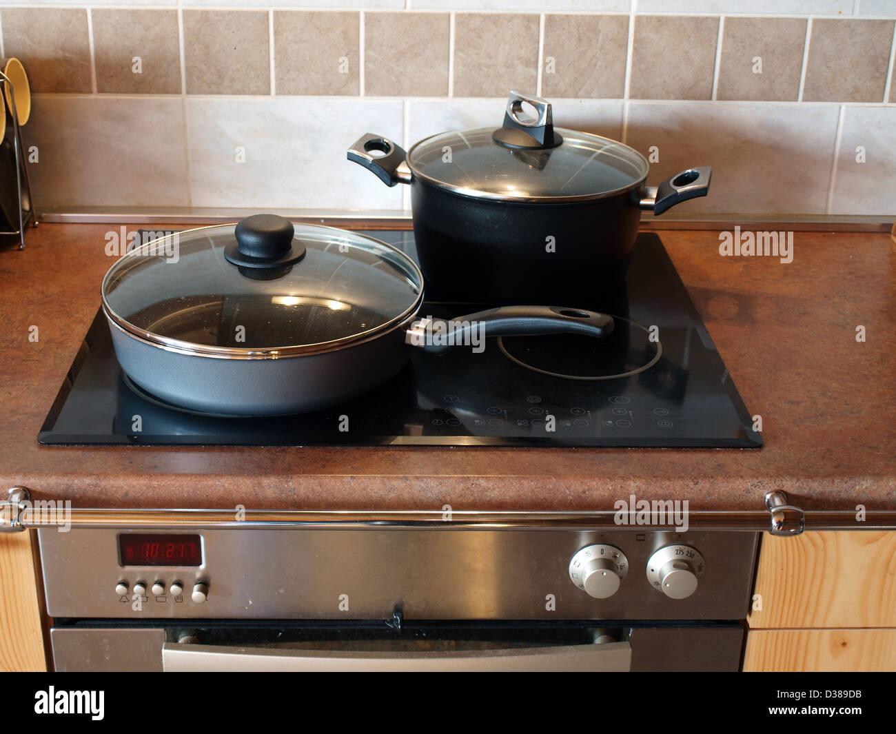 Modern ceramic electric stove in the kitchen - Stock Image