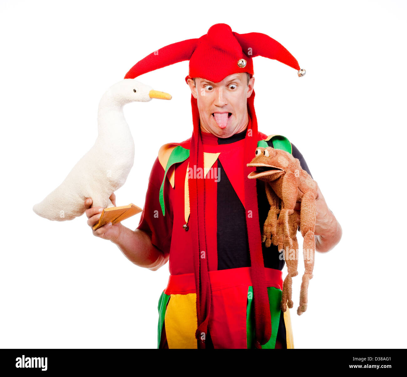 jester - entertaining figure in typical costume with puppets - Stock Image