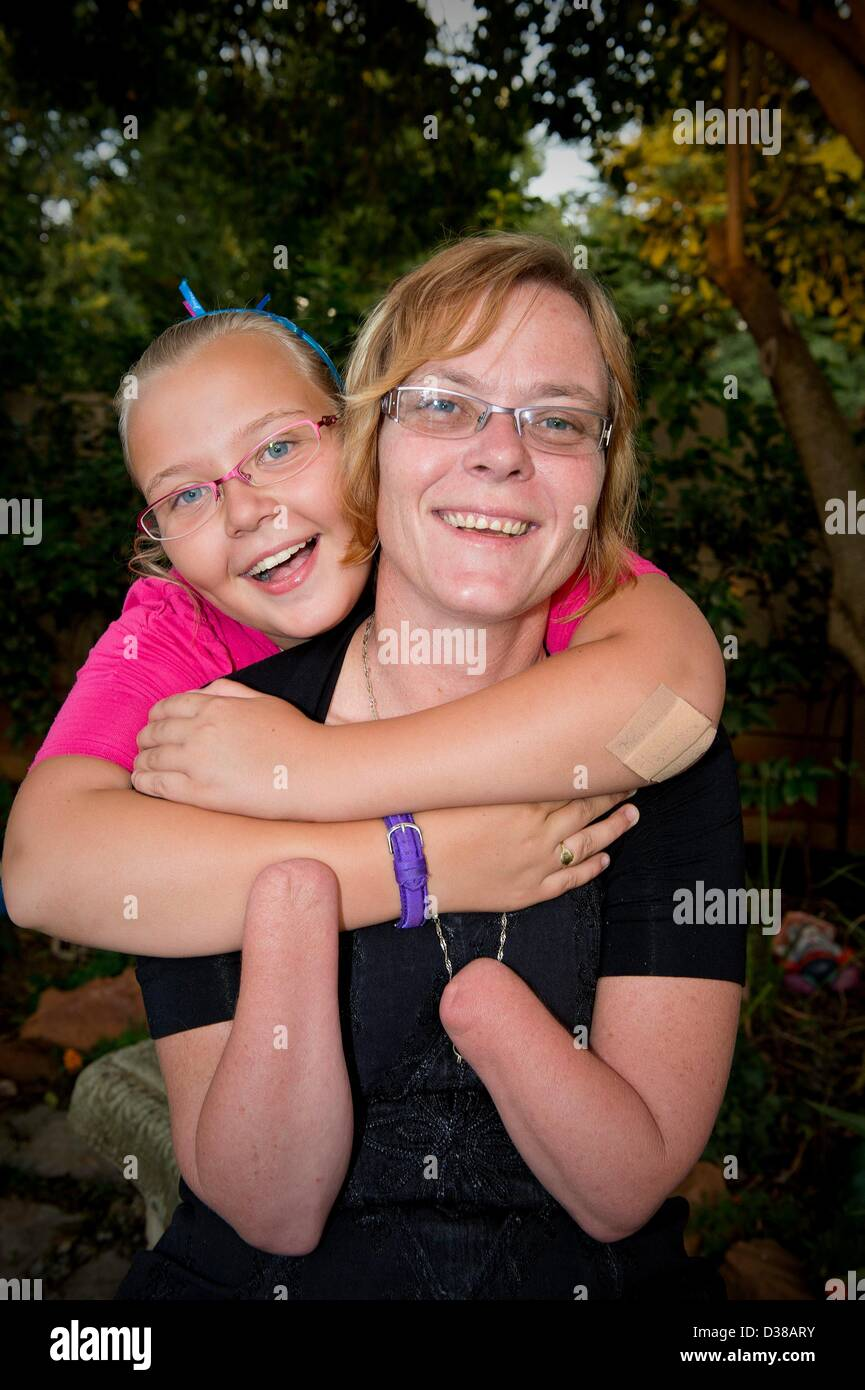 VEREENIGING, SOUTH AFRICA: Elize Henwood and her daughter, Elzandre, on February 2, 2013, in Vereniging, South Africa. - Stock Image