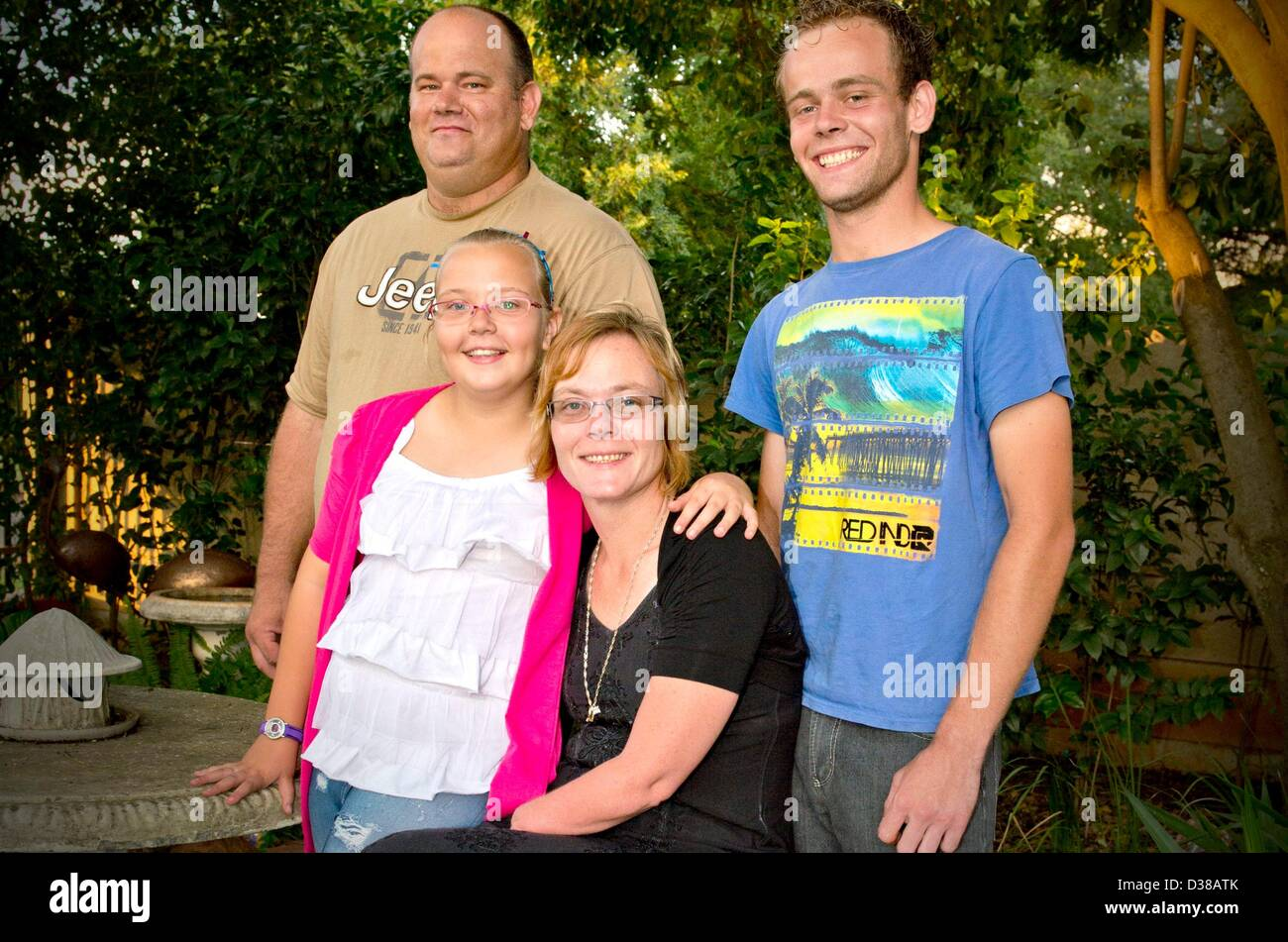 VEREENIGING, SOUTH AFRICA: Elize Henwood her daughter Elzandre, her husband Alex and their son, on February 2, 2013, - Stock Image