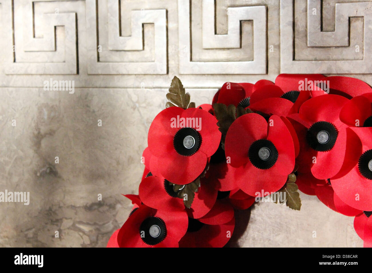 A Poppy Wreath laid at a World War Memorial in Birmingham, United Kingdom for the Remembrance day on 11th November. - Stock Image