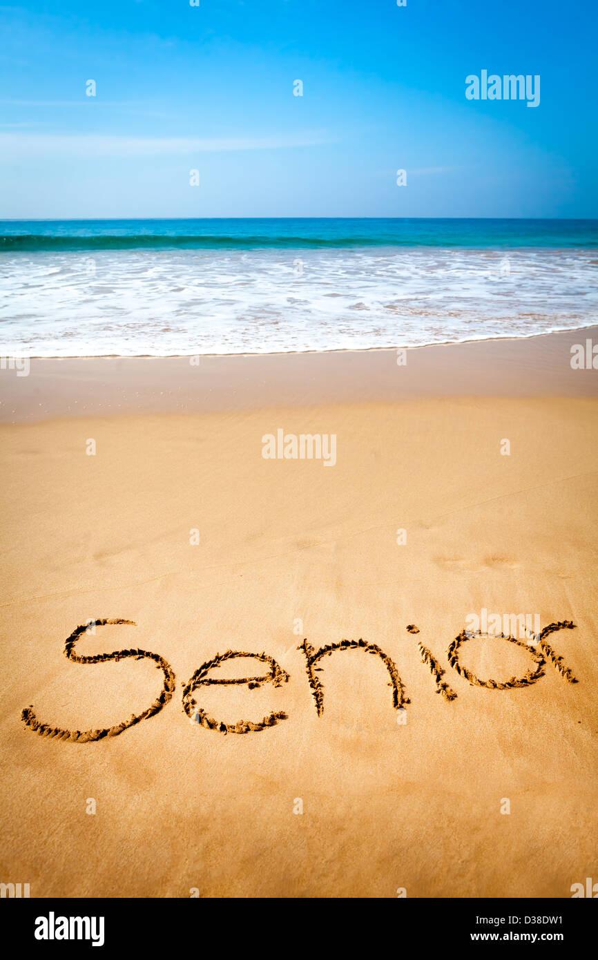 Word Senior Written in Sand, Tropical Beach - Stock Image