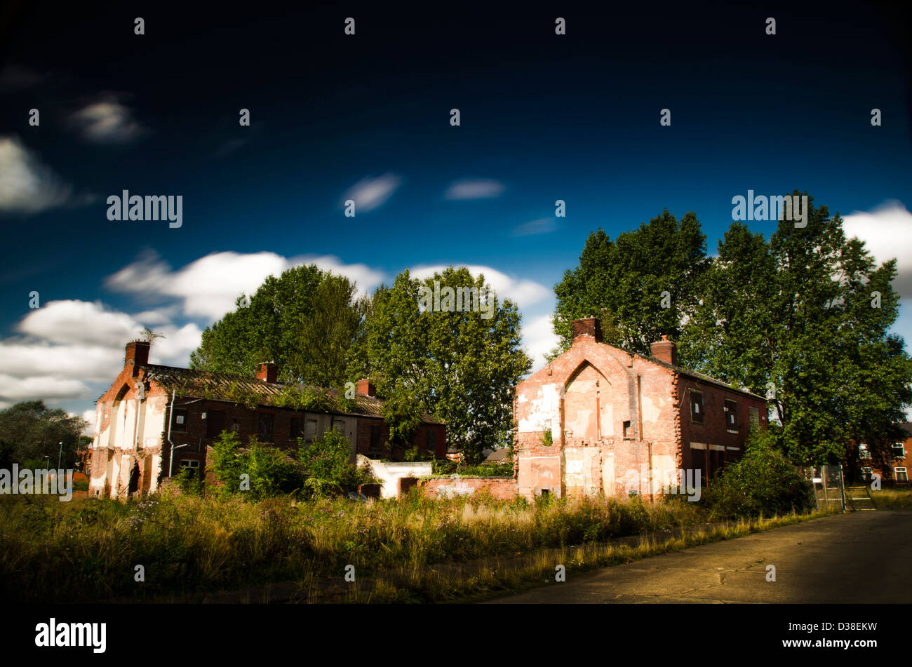 Urban decay, derelict houses, abandoned, renewal, trees blue sky, clouds, - Stock Image