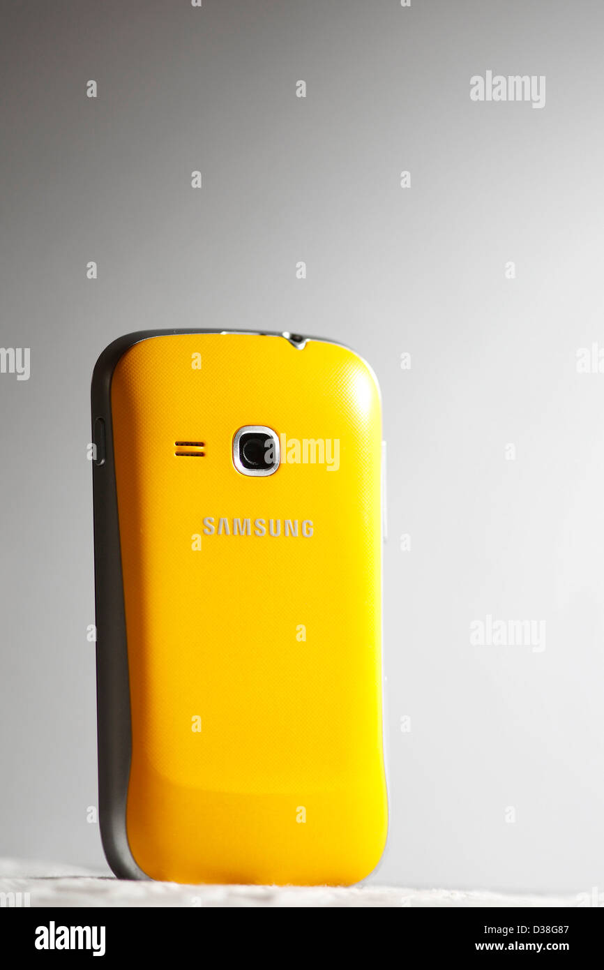 A yellow Samsung mobile phone. - Stock Image