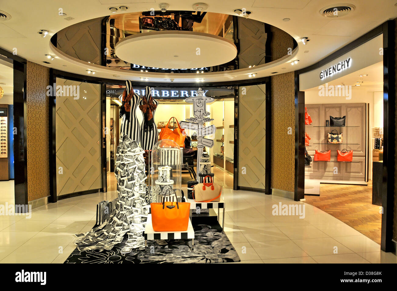 Burberry and Givenchy boutiques duty free shop Abu Dhabi international airport - Stock Image