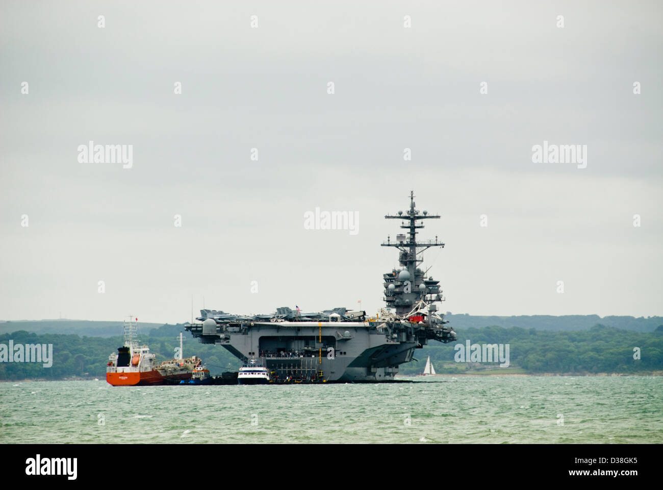 USS George HW Bush aircraft carrier anchored in the Solent off the Isle of Wight - Stock Image