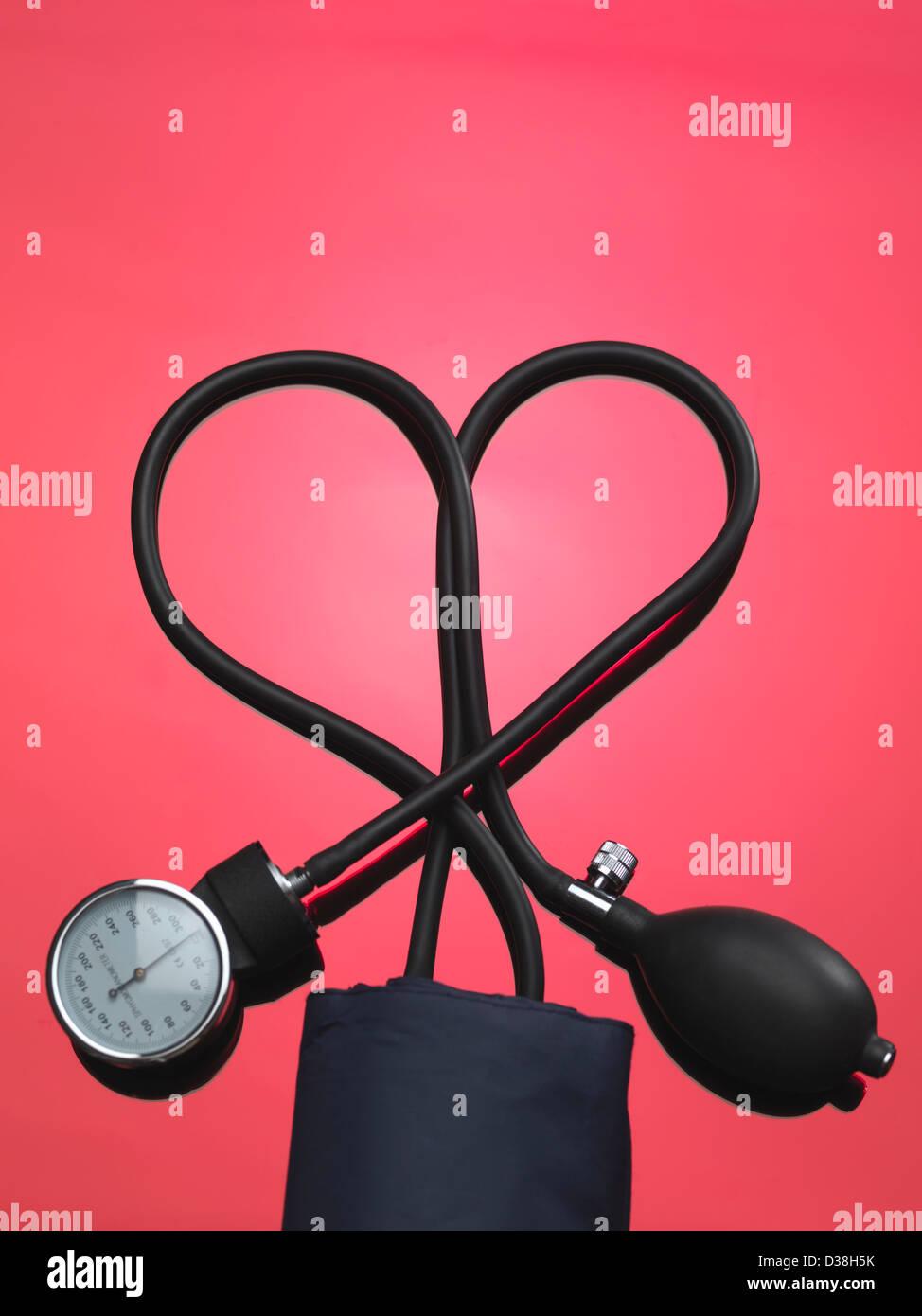 Blood pressure gauge in heart shape - Stock Image
