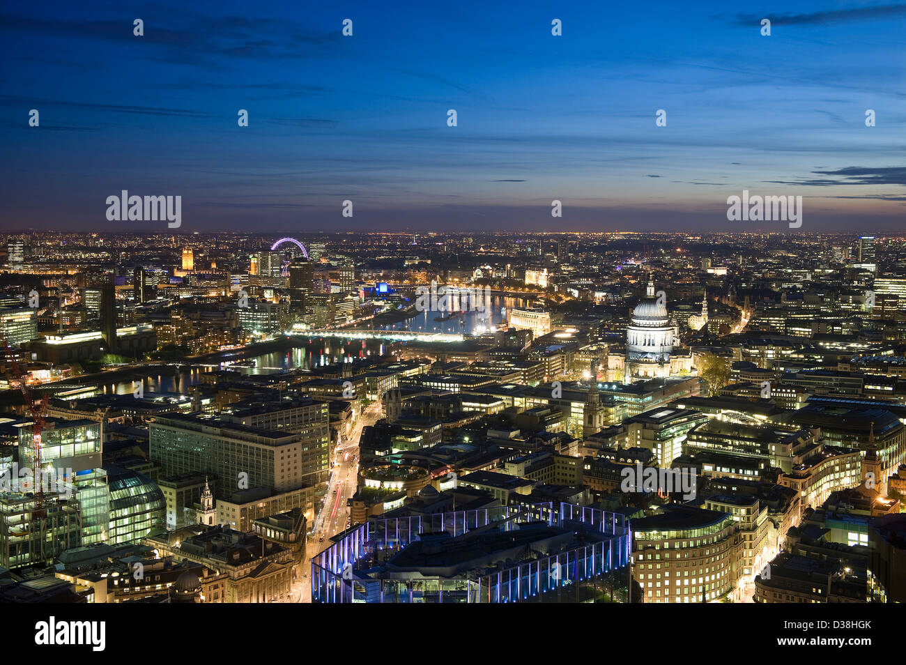 Aerial view of cityscape lit up at night - Stock Image