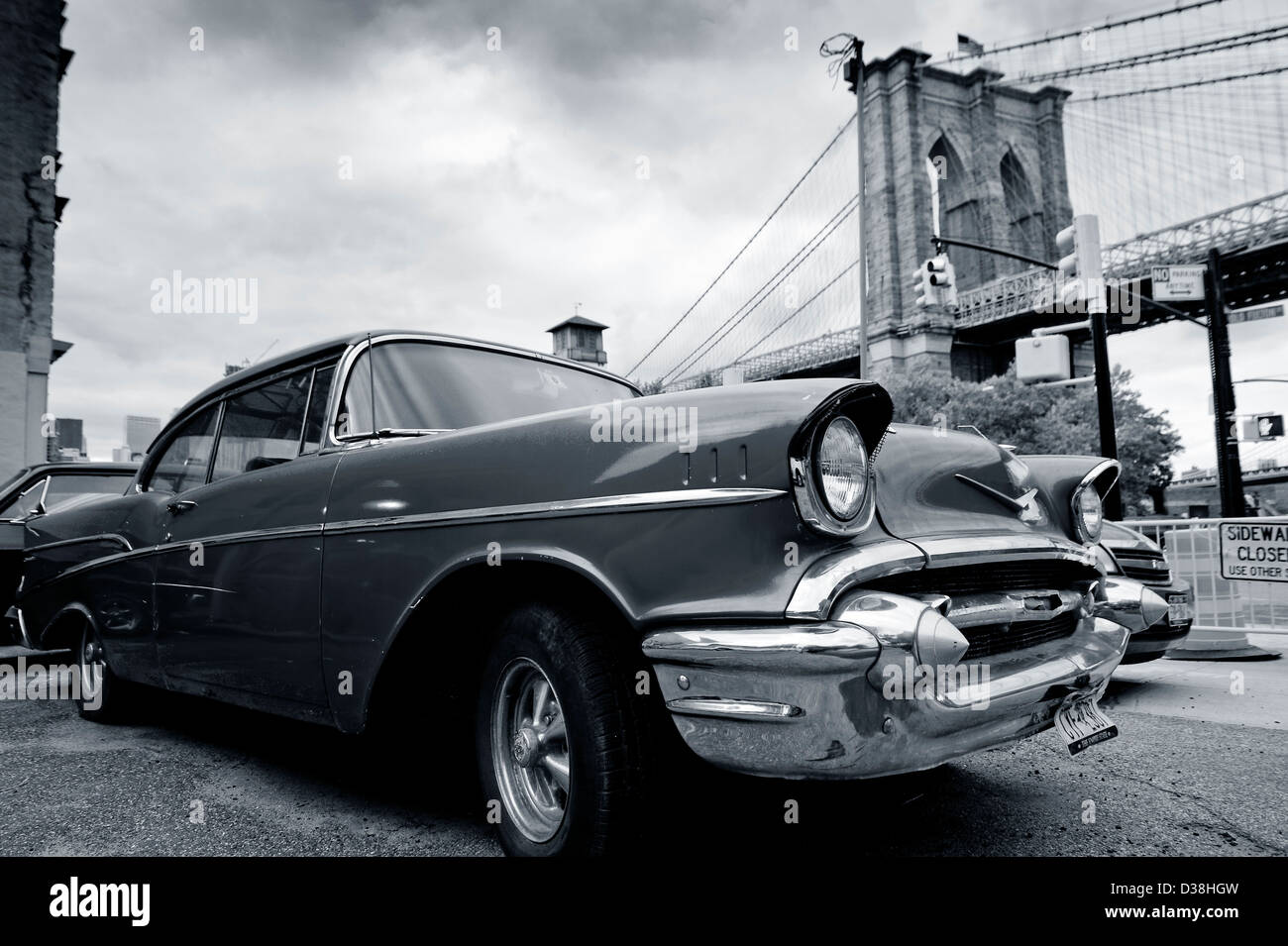Vintage car parked by city bridge - Stock Image