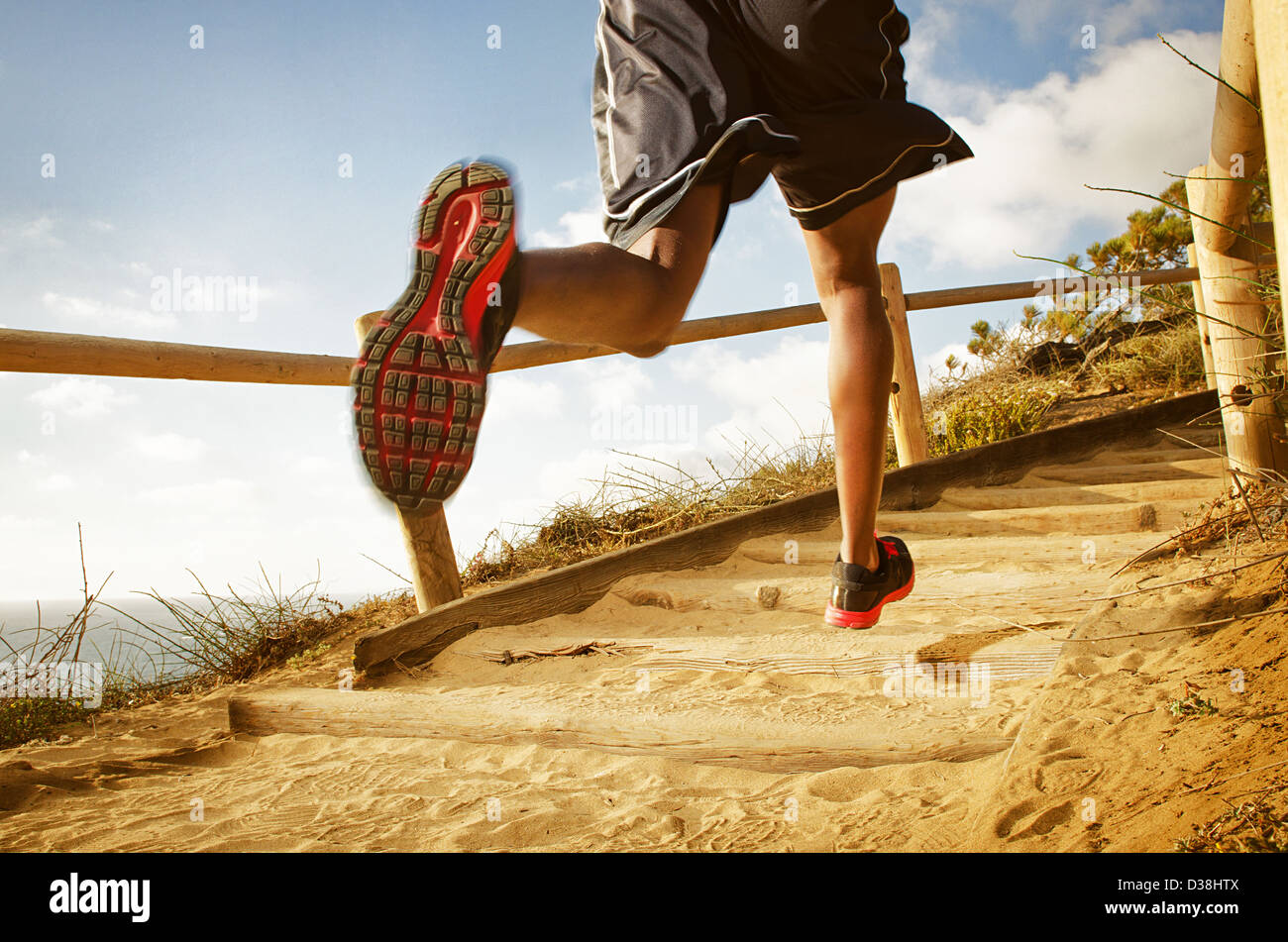 Man running on dirt path - Stock Image
