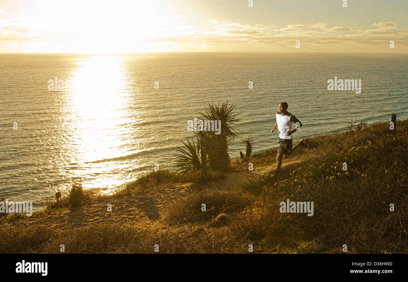 Man running on dirt path - Stock Image
