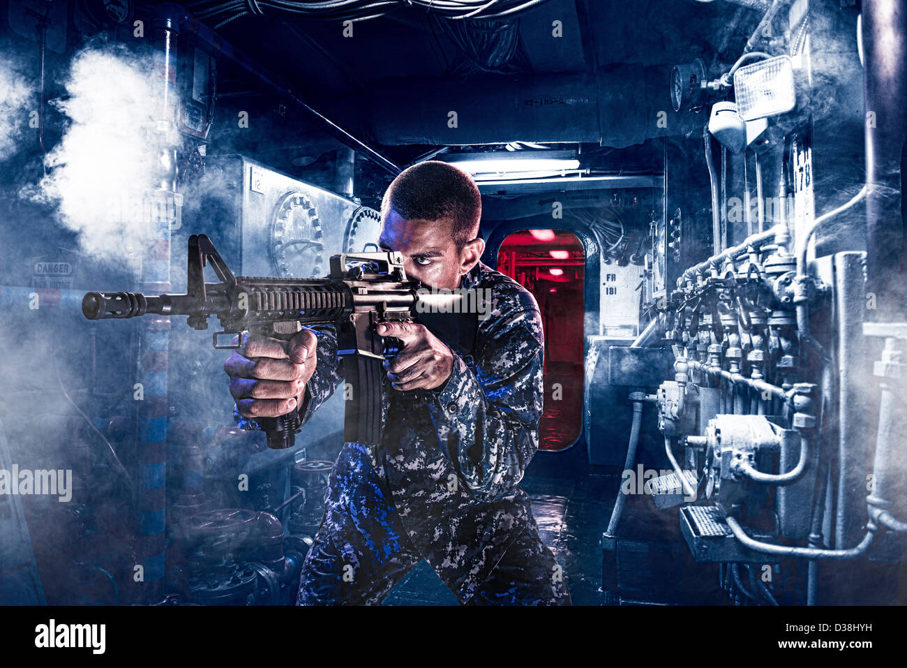 Soldier shooting assault rifle indoors - Stock Image