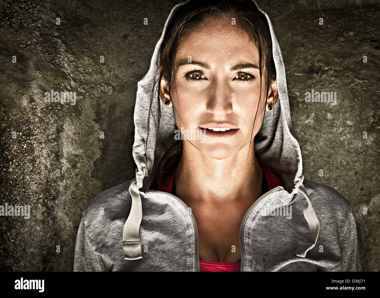 Close up of woman wearing hoody - Stock Image