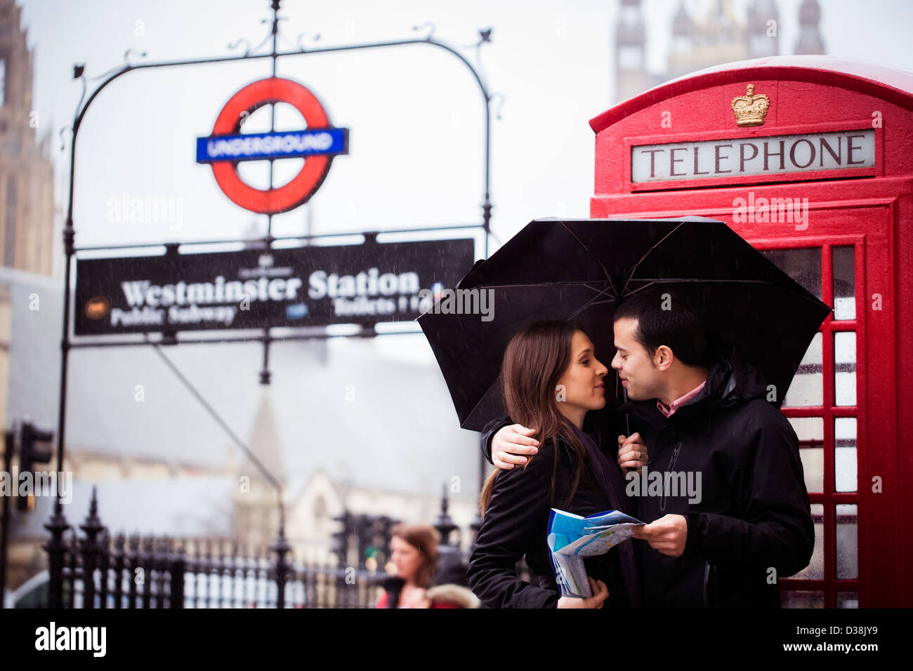 Sweet honeymoon couple in London famous site. - Stock Image