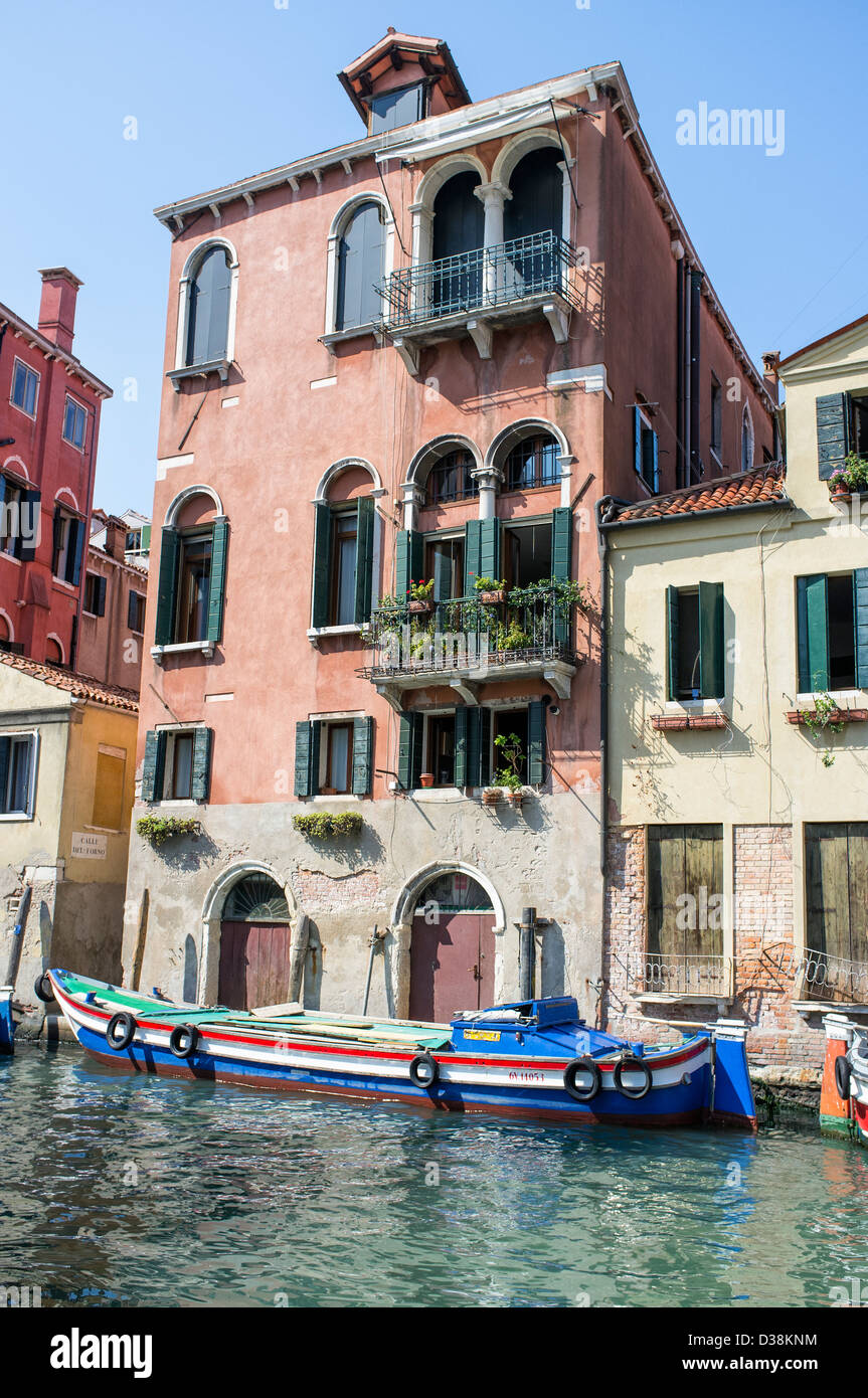 140ad493c Colourful Boat and Faded Buildings in Castello District of Venice ...