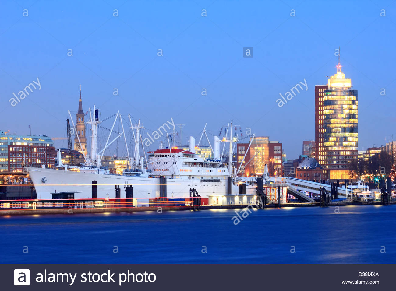Urban harbor lit up at night - Stock Image