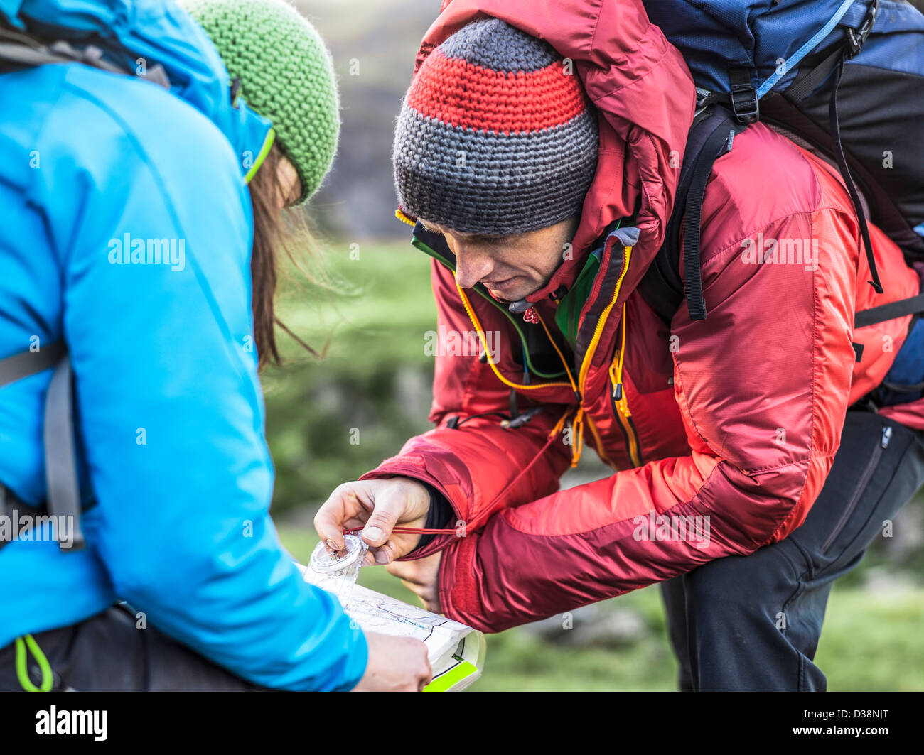 Hikers using map and compass - Stock Image