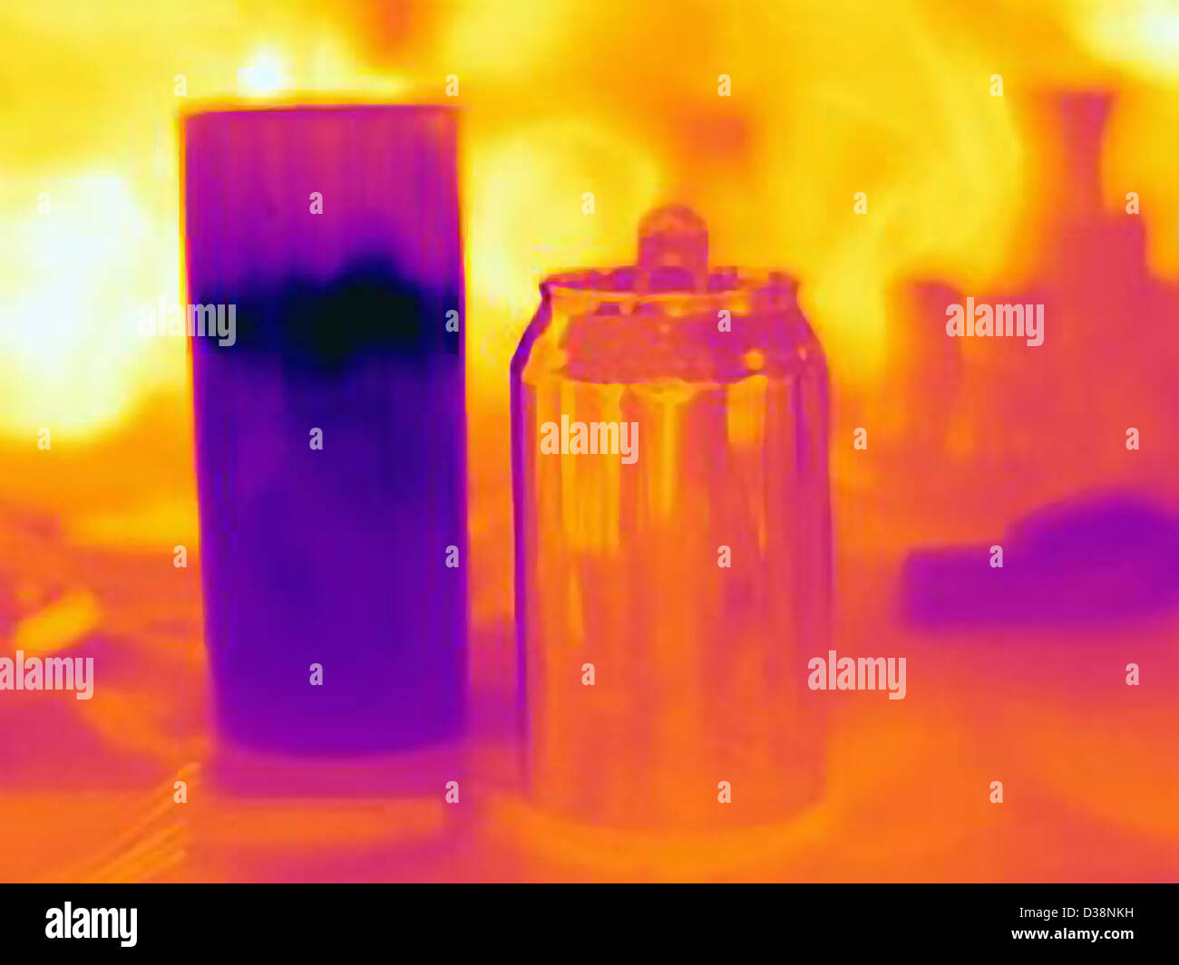 Thermal image of candle and can - Stock Image