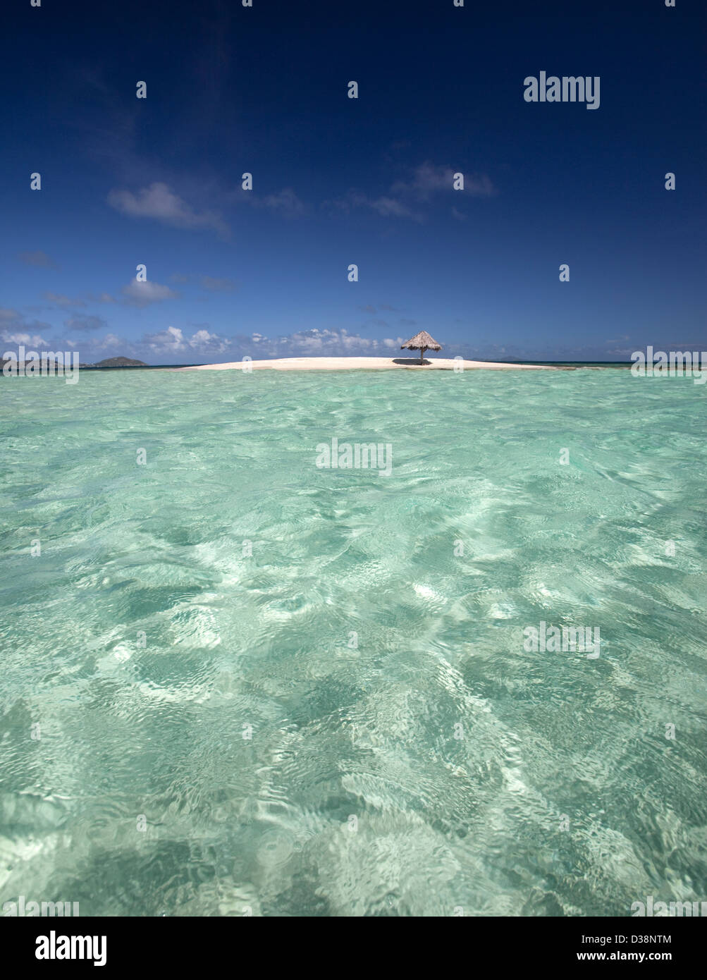 Tropical water and sandy beach - Stock Image
