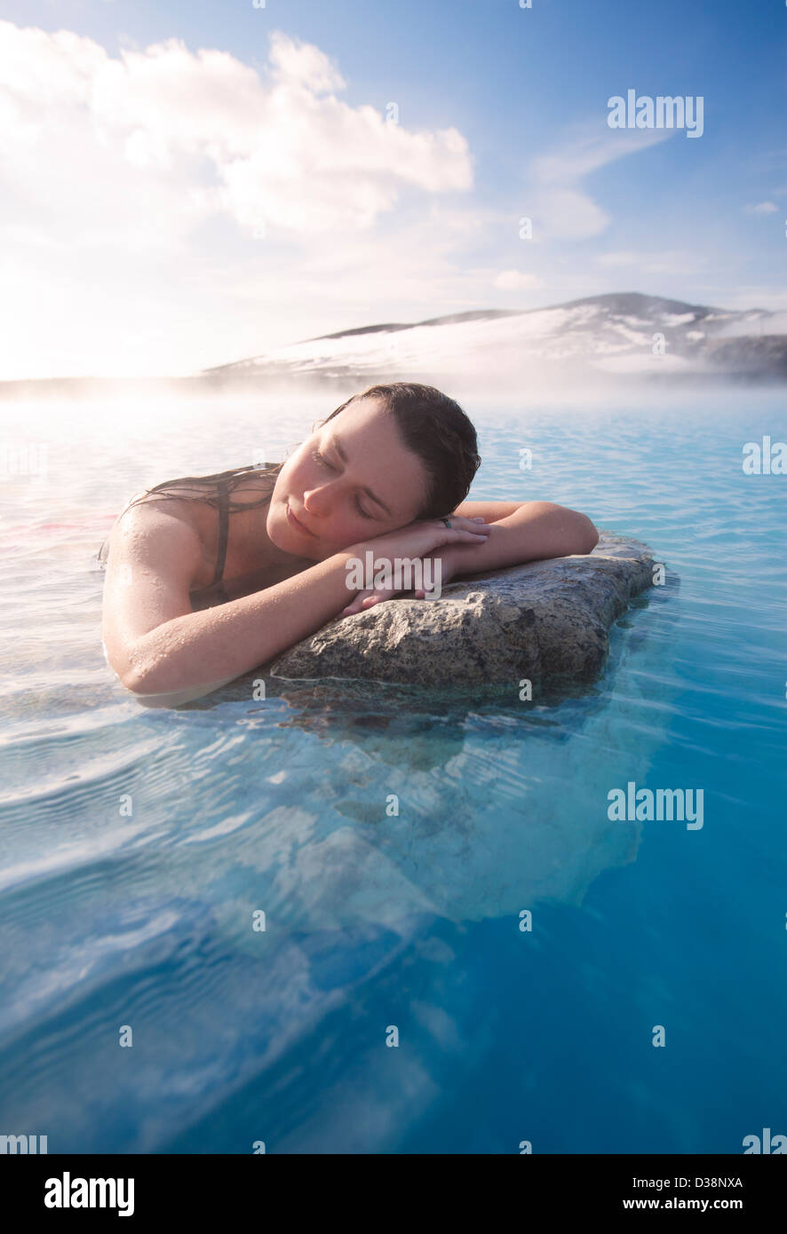 Woman relaxing in thermal lake - Stock Image