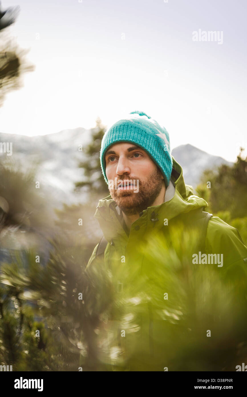 Man hiking in rural landscape - Stock Image