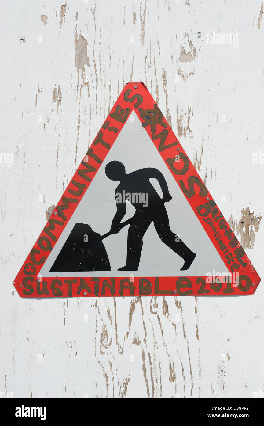 Altered road sign, with words added Sustainable Communities - Stock Image