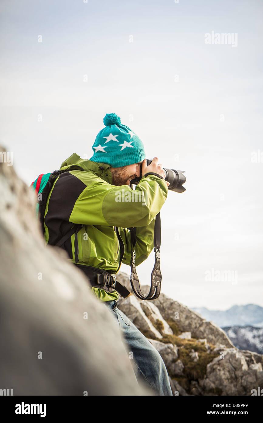 Hiker taking pictures in rural landscape - Stock Image