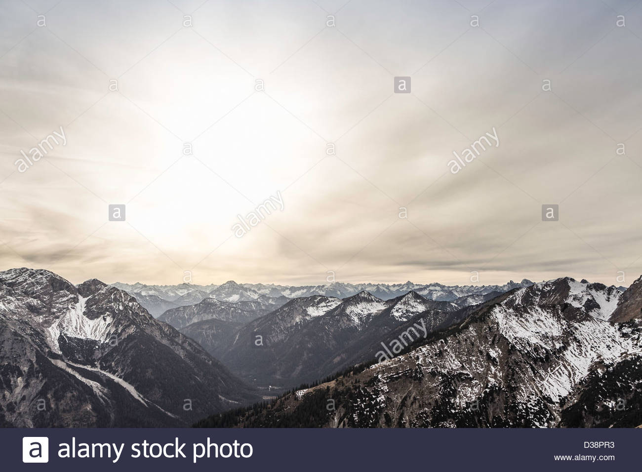 Clouds over mountains in rural landscape - Stock Image