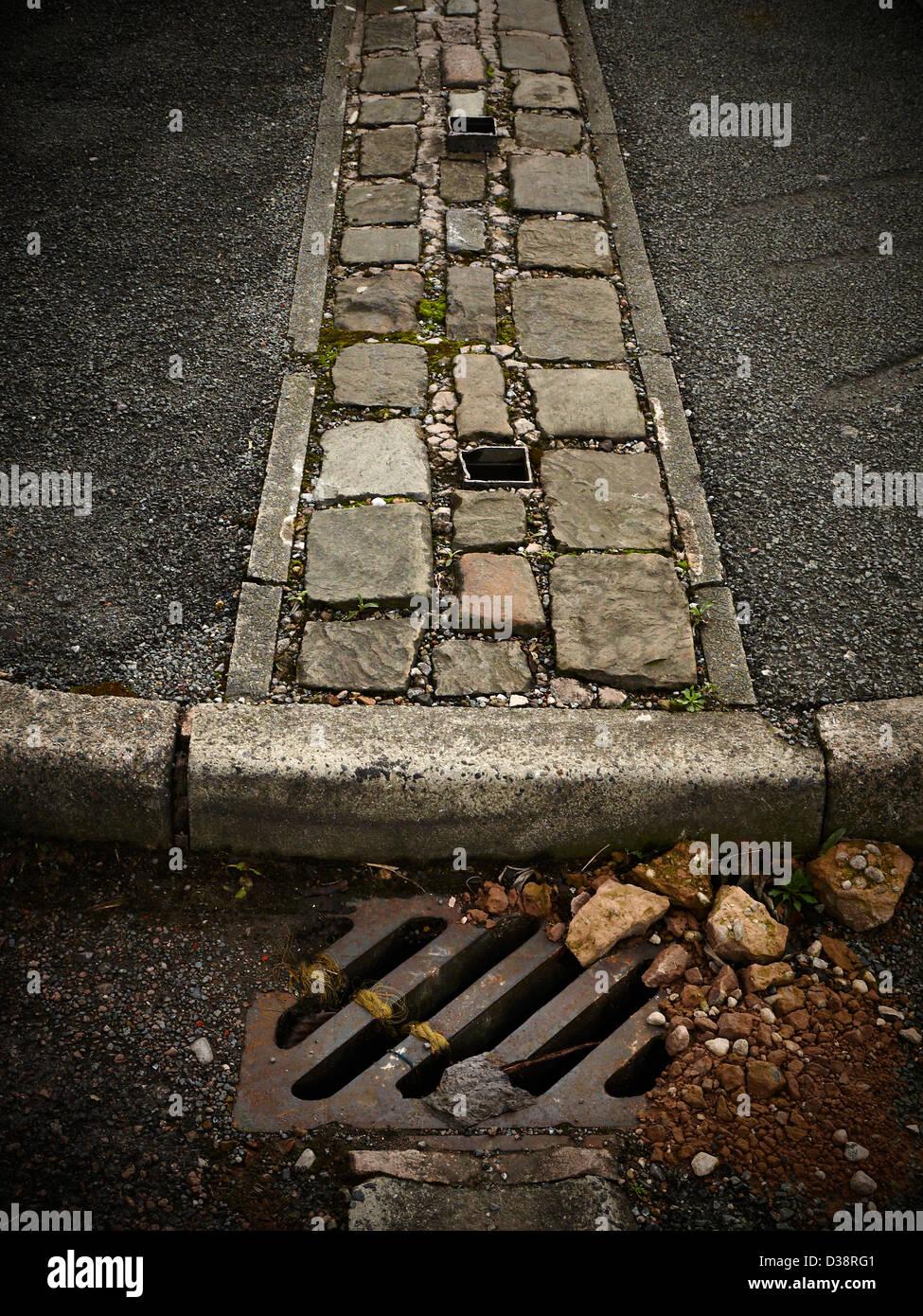 Manhole in street - Stock Image
