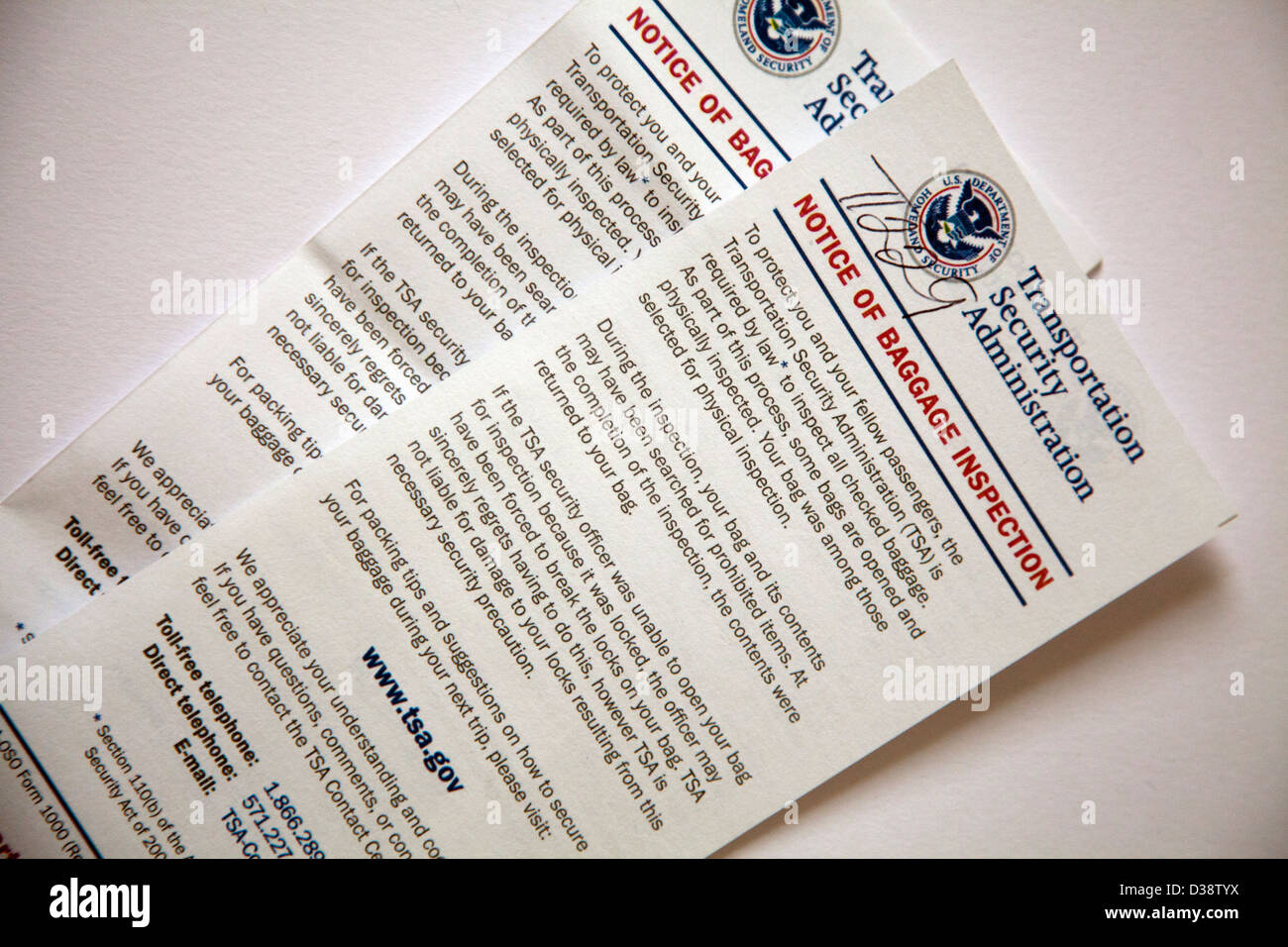 Transportation Security Administration forms placed in Luggage after USA customs inspected it. - Stock Image