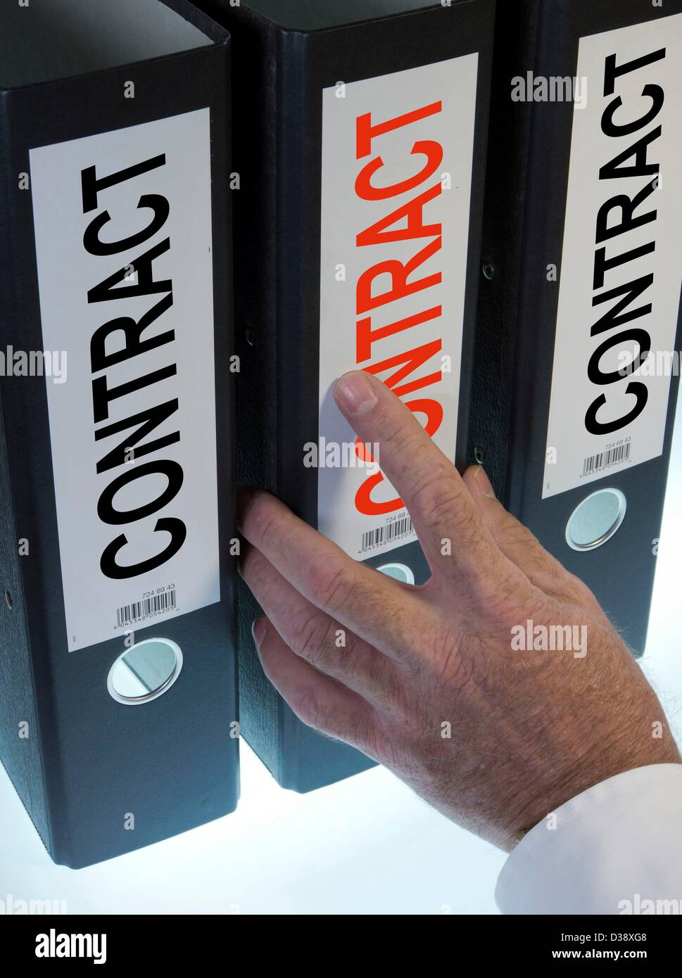 Symbol image,hand pointing to a file folder  labeled Contract - Stock Image